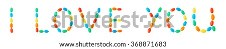 """I love you"" lettering made of multicolored candies isolated on white background"