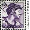 ITALY - CIRCA 1961: A stamp printed in Italy shows Erythraean Sibyl, fragment of painted ceiling of the Sistine Chapel, Vatican, fresco by Michelangelo, circa 1961 - stock photo