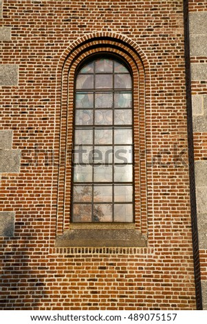 italy  lombardy     in  the  turbigo  old   church   closed brick tower   wall rose   window tile
