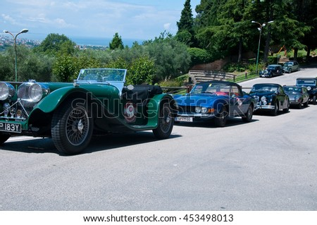 10 june 2016-gradara-italy-parade of vintage cars with jaguar , rolls royce,vintage