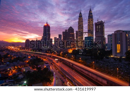 Kuala Lumpur, Malaysia - May 30, 2016 - Cityscape view of Petronas Twin Tower at KLCC City Center during sunrise. The most popular tourist destination in Malaysian capital.