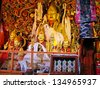 LHASA, TIBET-NOVEMBER 13: Buddha statue in the Sera Temple. This historic temple is one of the holiest sites in Tibetan Buddhism. November 13, 2004 in Lhasa, Tibet - stock photo