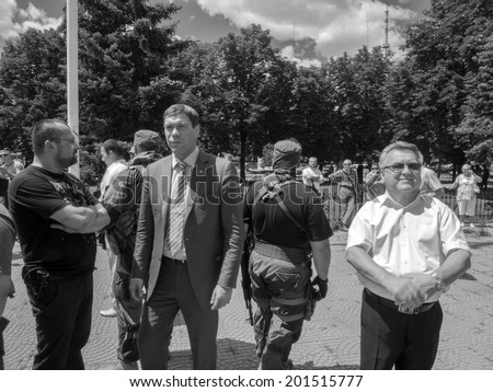 "LUHANSK, UKRAINE - June 29, 2014:  The self-proclaimed Novorossia parliament speaker Oleg Tsarev (center) ansk republic"" Valery Bolotov."