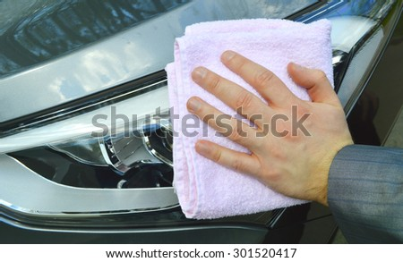 man washing a car with a rag