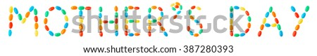 """mother's day"" lettering made of multicolored candies isolated on white background"