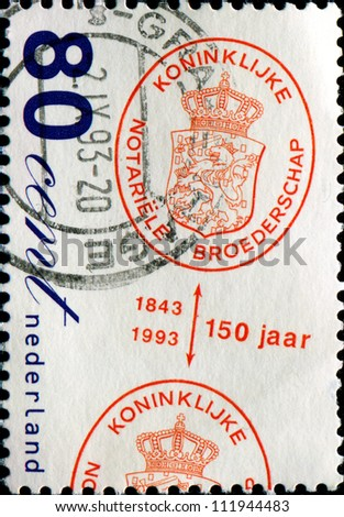 NETHERLANDS - CIRCA 1993: A stamp printed in Netherlands shows  Emblems of Royal Dutch Notaries Association (150 Jaar reading up), 150th Anniversary of Association, circa 1993