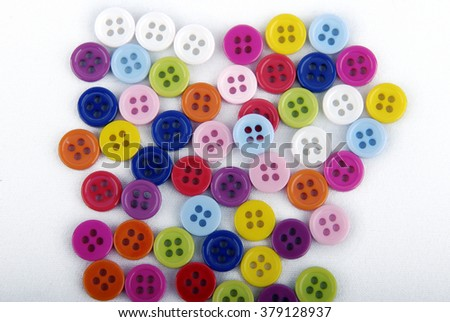 ?olorful buttons on a white background