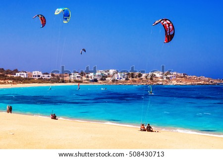 22.06.2016 - Paragliders and tourists at Mikri Vigla beach on Naxos island, Greece