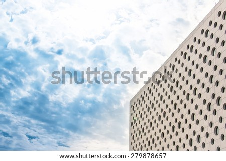 part of modern business building against blue sky