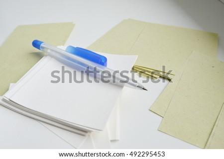 pen for writing and clean white sheets of paper. A bunch of sheets of paper