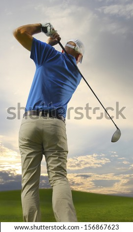 Photograph of a golfer finishing a full swing