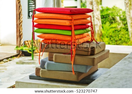 pile of colorful decorative chair pillows