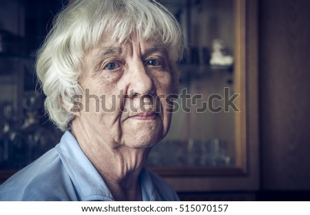 Portrait of a tired elderly woman