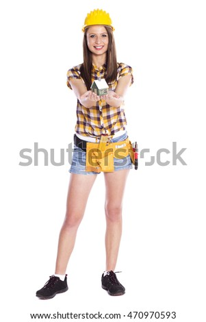 portrait of attractive female carpenter holding house isolated on white