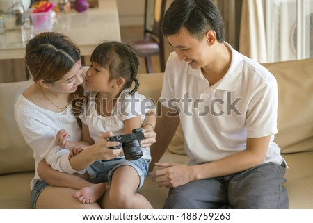 portrait of family ,Happy Asian Family enjoying family time together ,family look at the camera and smiling at home, Beautiful family
