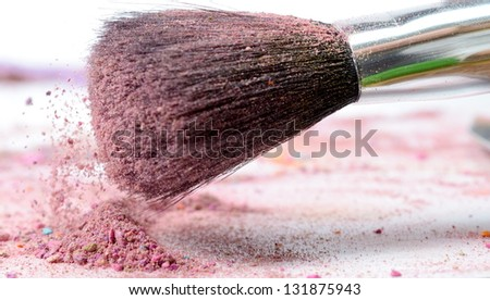 professional make-up brush on colorful crushed eyeshadow