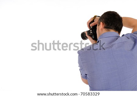 professional male photographer from back taking picture.copyspace . isolated on white background