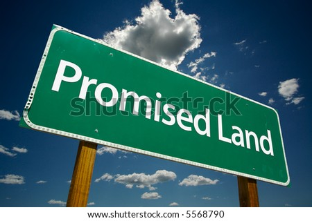 """Promised Land"" Road Sign with dramatic clouds and sky."