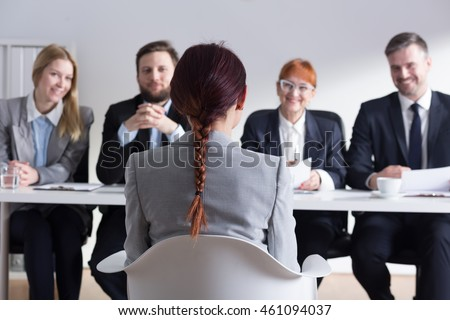 Recruiters listening intently to female job applicant