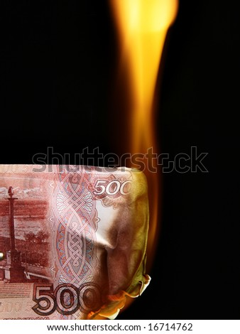 5000 russian rubles bills on fire over black background