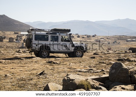 Sani Pass, Lesotho - July 15, 2016. Vehicle Land Rover Defender is doing off-road trail in Lesotho next to Sani Pass.