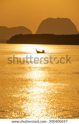 Silhouettes of fishing boats in the South, with the morning light, Thailand.