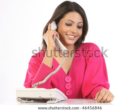 Smiling teenage girl chatting on the telephone