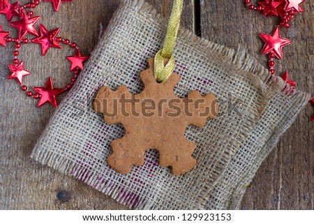 Snowflake shape gingerbread cookie on the sacking