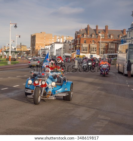 Southport, Sefton, UK. December 6th 2015. Santa road event at Southport with dressed trucks, cars and motorbikers