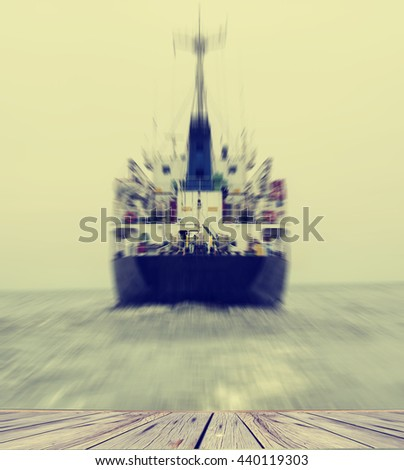 Stern of the ship in close up with working screw and rudder view back ship in the sea,Image blur style and vintage tone