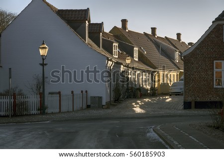 Street corner with old houses, street lamp and car in royal town Ribe, Denmark
