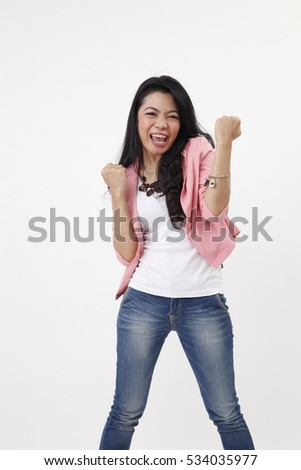 success business woman celebrating screaming and dancing of joy winning