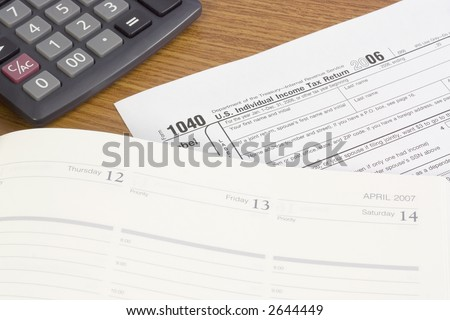 1040 tax form with calculator and calendar