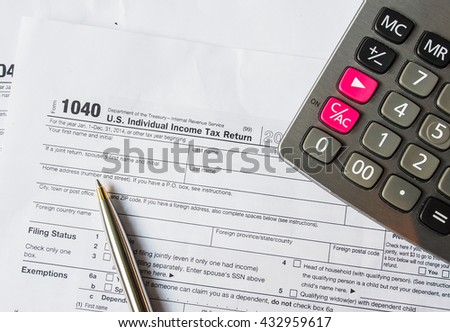 Tax form calculator money pen stock photo 492344017 for 1040 tax table calculator