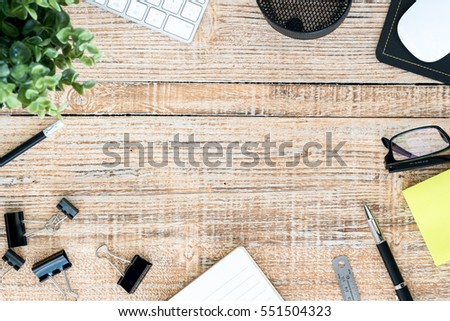 Top view,Wooden table with office supplies