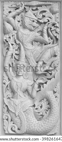 Traditional Old wood carving on the wall of Temple in Thailand,  Thai style