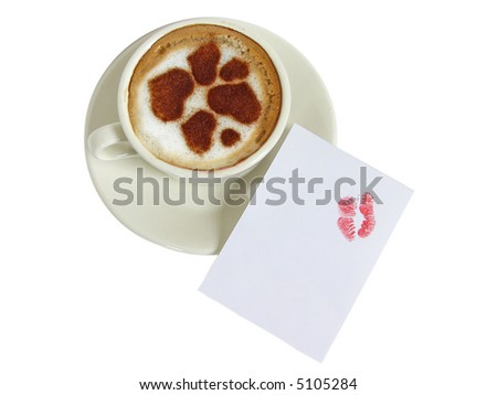 ?up of coffee-cappuccino with lipstick traces  and with cinnamon drawings of hearts