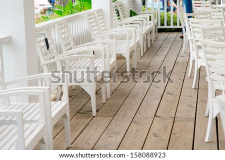 white wooden chair and wooden floor