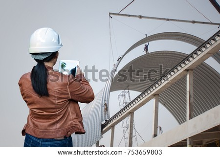 Lovely Woman Engineer Contractor Control Crane Lifting Shell Unless Frame Metal  Sheet Roofing Construction Site Work