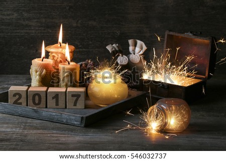 2017 written on cubes on wooden background