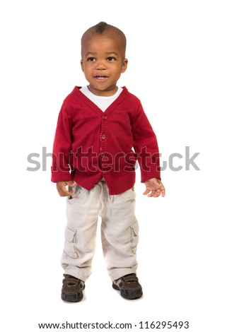 1 year old baby boy standing wearing holiday red sweater on isolated on white background