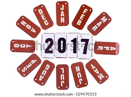 2017 year symbols and red month tiles around the date. Isolated on a white background