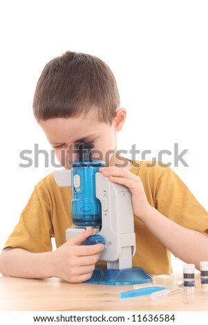 6 years old boy with microscope isolated on white