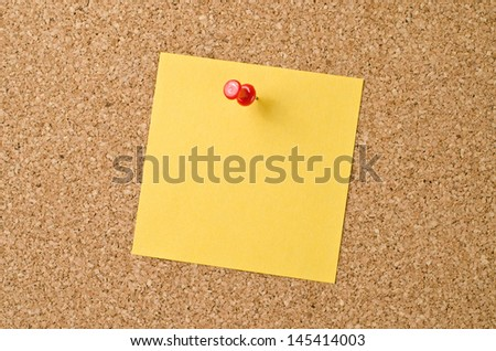 Yellow note paper on cork board