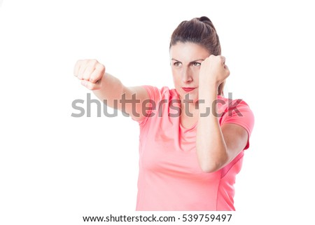 Young girl dressed in sport making a fight gesture isolated on white background