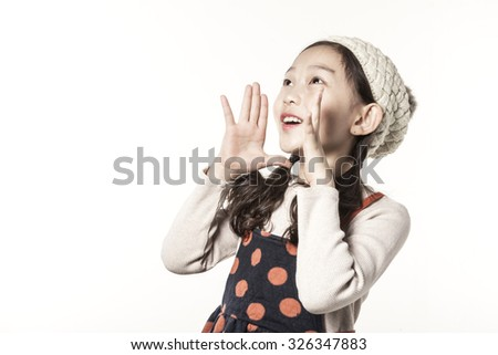 A asian(japnanese, chinese, korean) girl(kid, children) shout(cry, speak loudly) in the winter, christmas isolated white at the studio.
