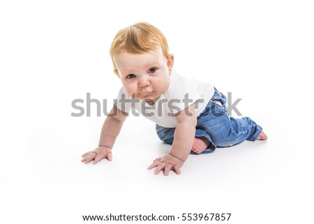 A baby walk on knee on studio white background