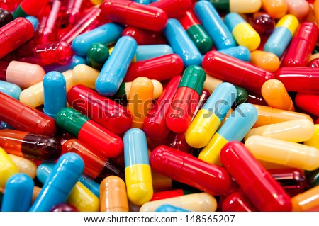 A background of various colorful capsules