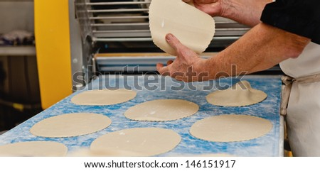 a baker prepares pastry in a french patisserie