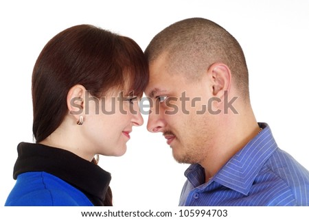 A beautiful adult couple standing arm in arm on a white background